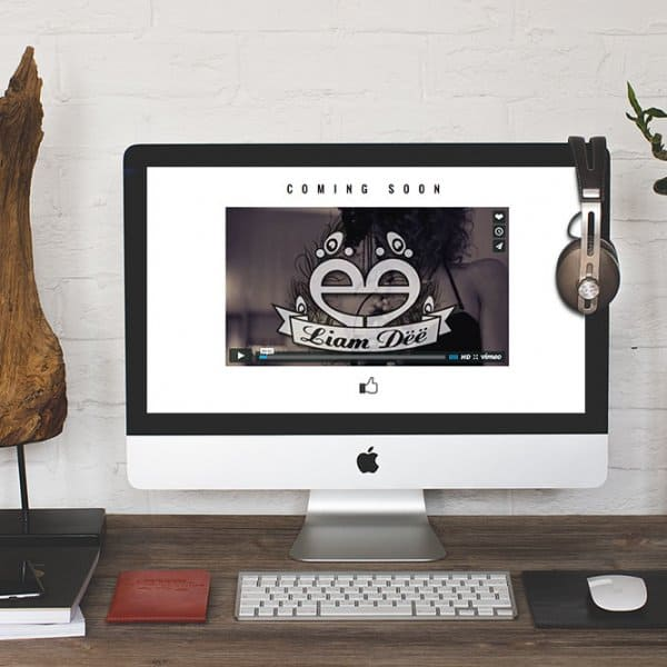 Liam Dee logo design, website design on iMac
