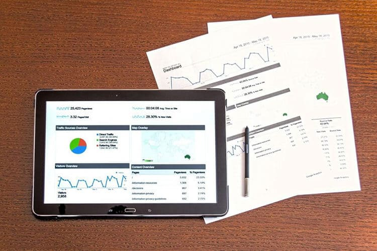 data analytics on a tablet and paper