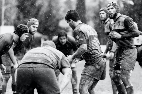 Rugby team playing. Personal development improves the teams, not just ourselves.
